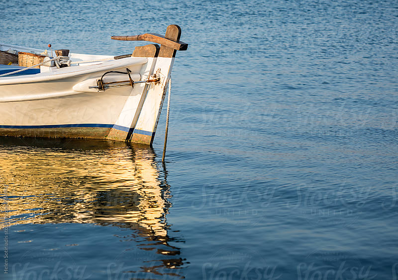 Partial View of a Fishing Boat in the Water by Helen Sotiriadis for Stocksy United