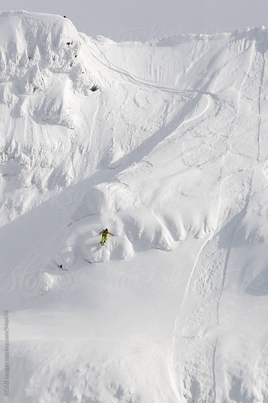 Free skier riding down the mountain by RG&B Images for Stocksy United