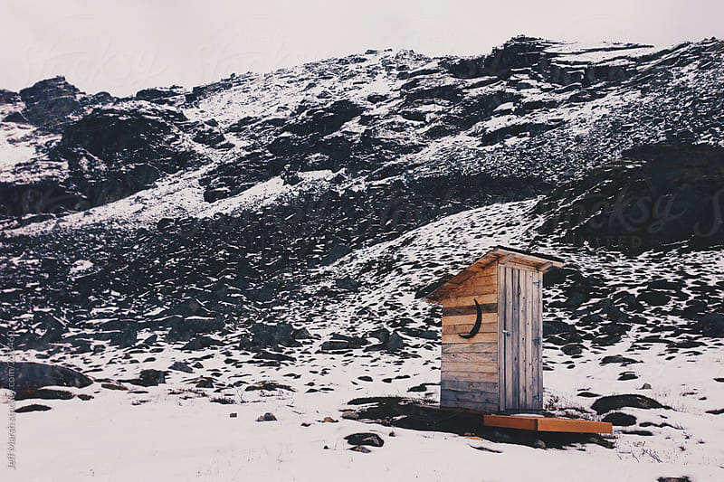Outhouse in snow by Jeff Marsh for Stocksy United