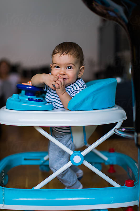 Happy Baby Boy in a Walking Chair by Mosuno for Stocksy United