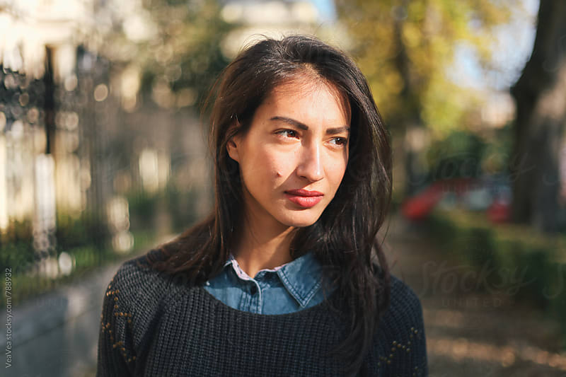 Portrait of a beautfiul brunette woman outdoors by Marija Mandic for Stocksy United