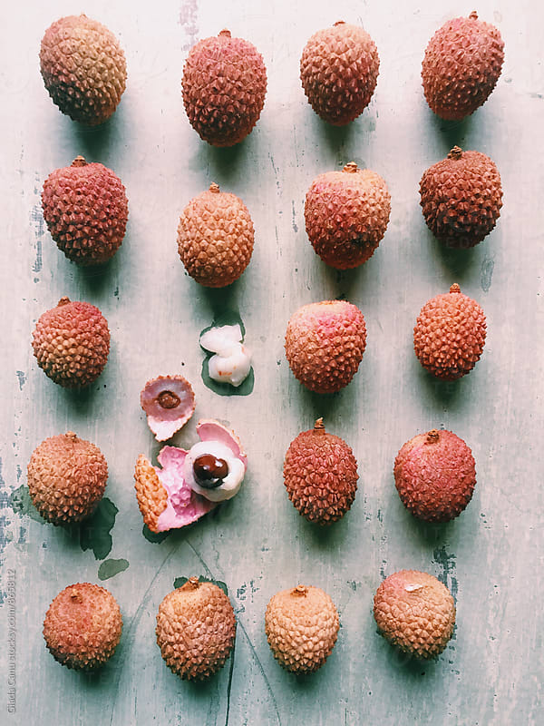 Lychee on wooden background -  by Giada Canu for Stocksy United