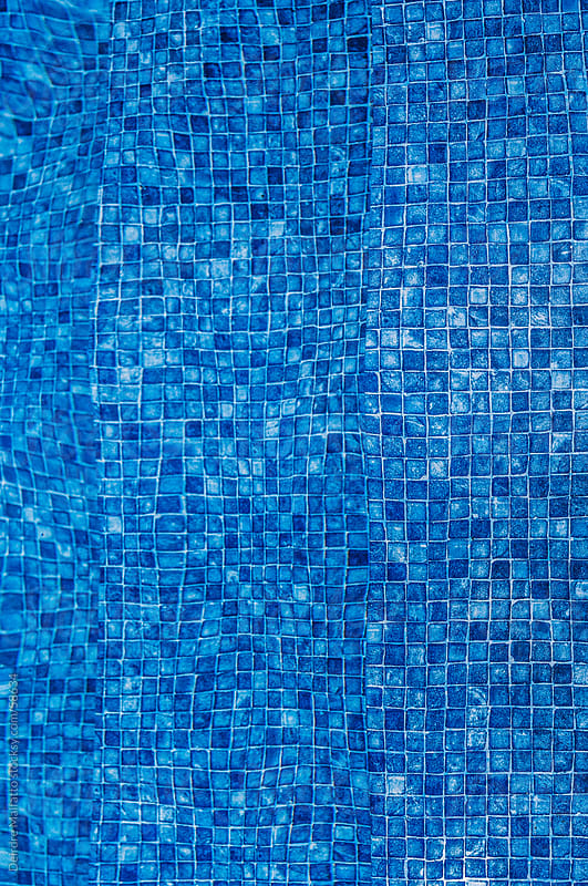 tiles underwater at the bottom of a swimming pool,  by Deirdre Malfatto for Stocksy United