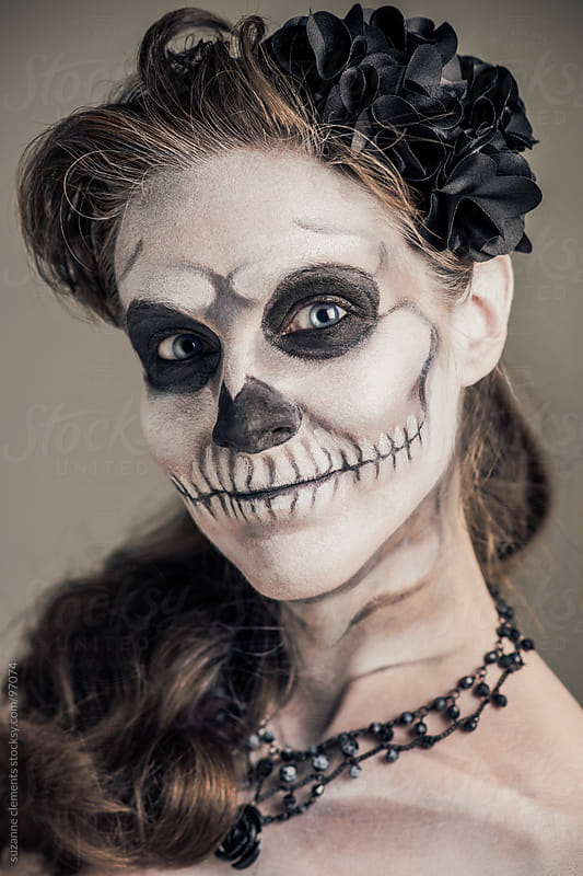 Woman Painted as a Frightening Skeleton by suzanne clements for Stocksy United