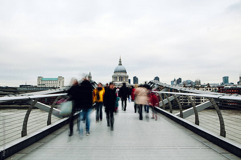 View of St Paul's Cathedral in London with people walking across the Millennium bridge. by kkgas for Stocksy United