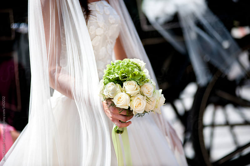 Bride with bouquet of white roses by Jean-Claude Manfredi for Stocksy United