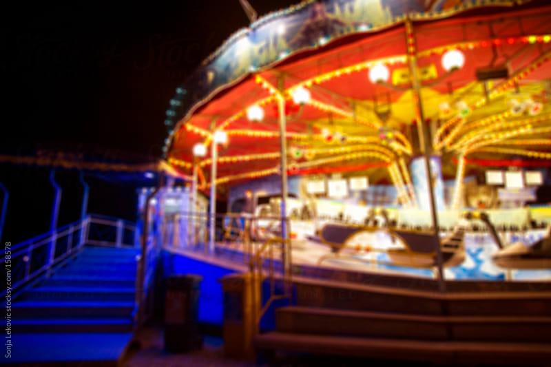 amusement park in blur by Sonja Lekovic for Stocksy United