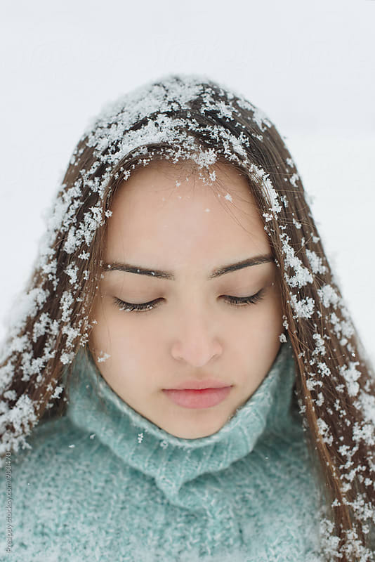 Portrait of a beautiful girl covered with fresh fallen snow in her hair by Preappy for Stocksy United