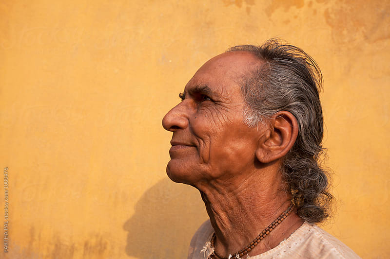 Side face of a 70 year old man by PARTHA PAL for Stocksy United