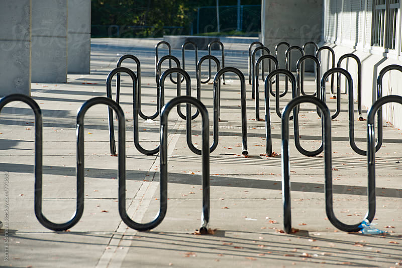 Empty Bike Racks by Ronnie Comeau for Stocksy United