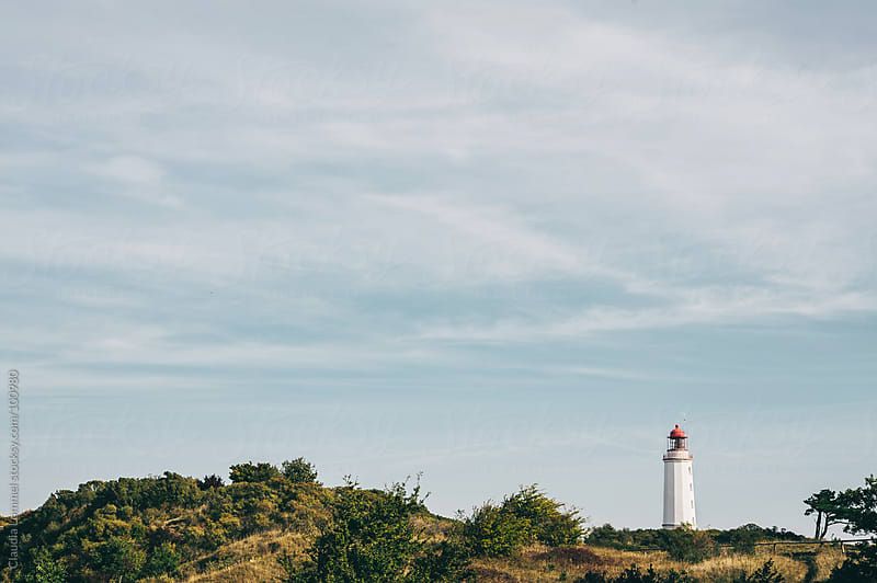 Lighthouse in the Dunes at the Baltic Sea, Germany by Claudia Lommel for Stocksy United
