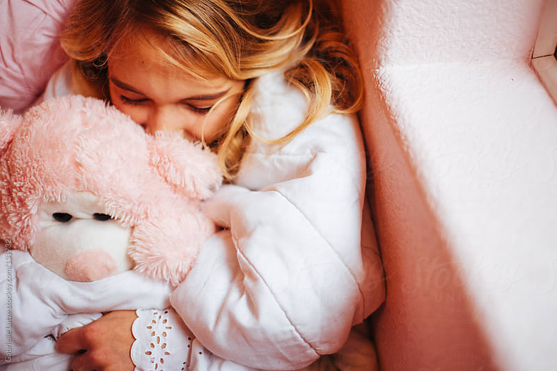 Beautiful Girl Cuddling with Bear by Gabrielle Lutze for Stocksy United