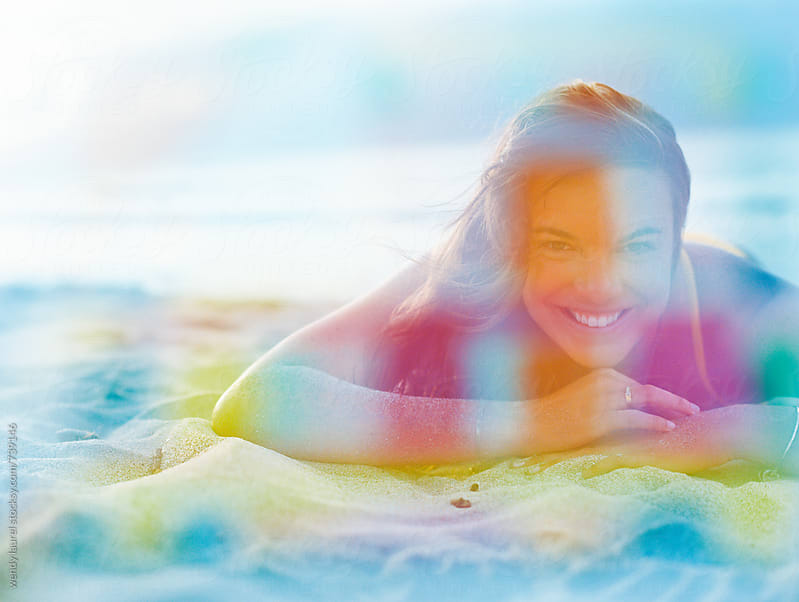 girl on beach overlaid with bright colors on film by wendy laurel for Stocksy United