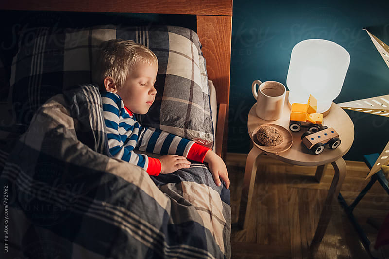 Blond Boy Sleeping in Bed by Lumina for Stocksy United