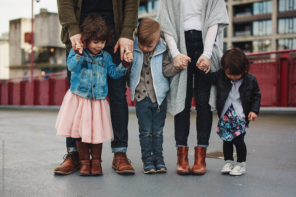 Family of five standing together - kids and feet only by ...