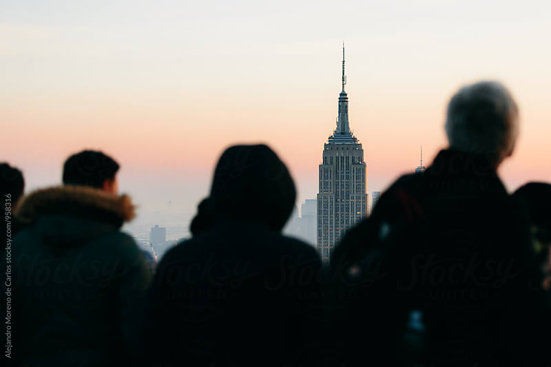 Silhouette of tourists and view of Empire State building by Alejandro Moreno de Carlos for Stocksy United
