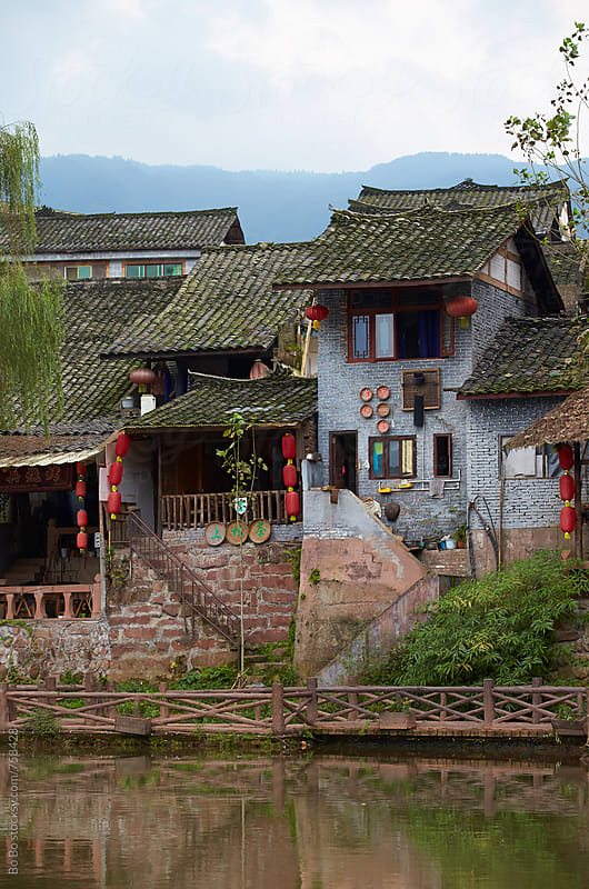 Chinese village by the river by Bo Bo for Stocksy United