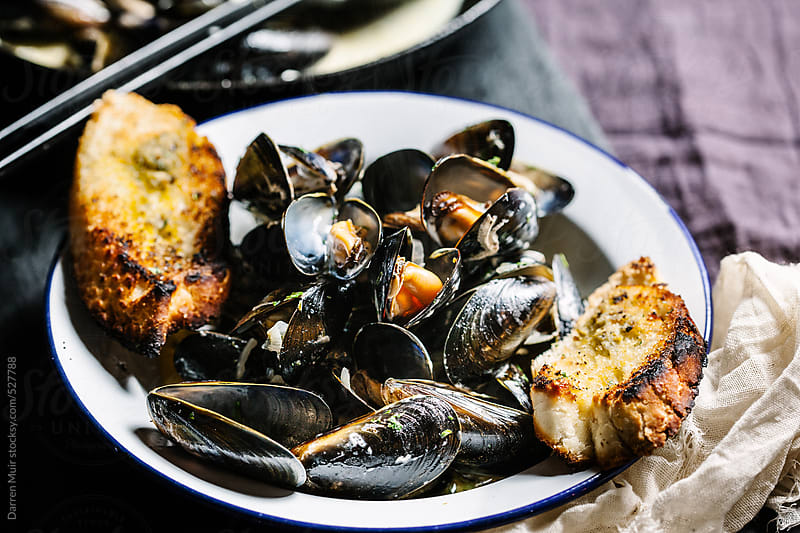 Classic dish of Moules mariniere. by Darren Muir for Stocksy United