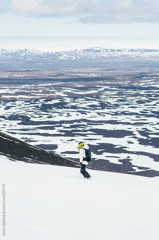 Young snowboarder riding down Mt. Hekla volcano in Iceland by Søren Egeberg Photography for Stocksy United