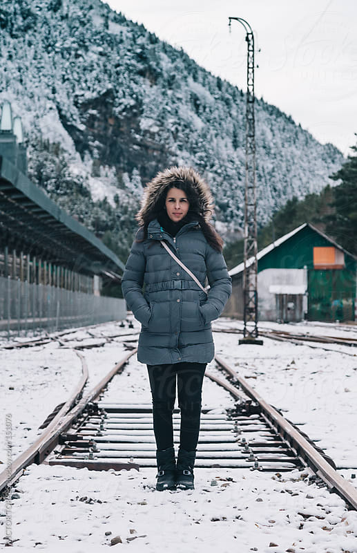 Woman Standing in a Railway by VICTOR TORRES for Stocksy United