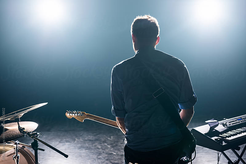 Male guitarist performing on the stage  by RG&B Images for Stocksy United