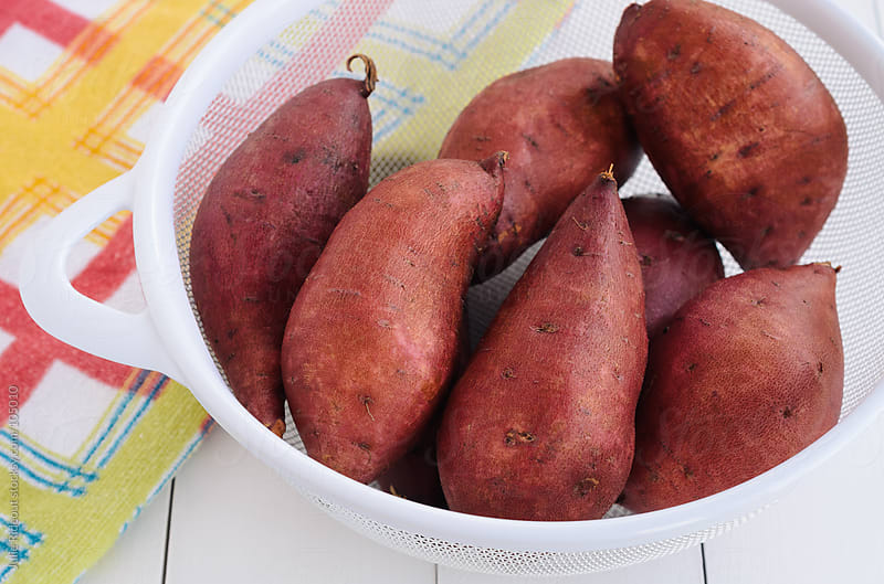 Fresh Sweet Potatoes by Julie Rideout for Stocksy United