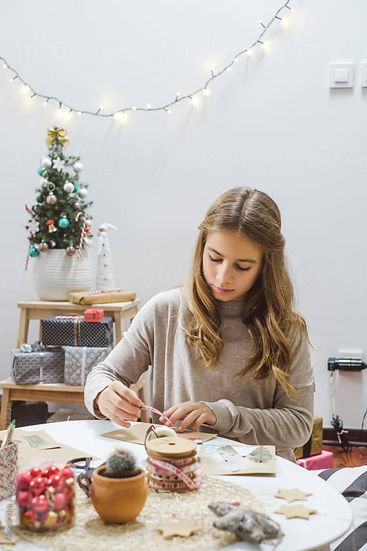 Beautiful Teenage Girl Making Christmas Cards at Home by Aleksandra Jankovic for Stocksy United