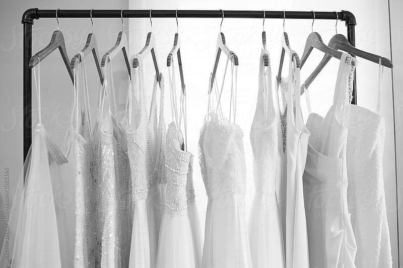 Rack of wedding dress by Jennifer Brister for Stocksy United