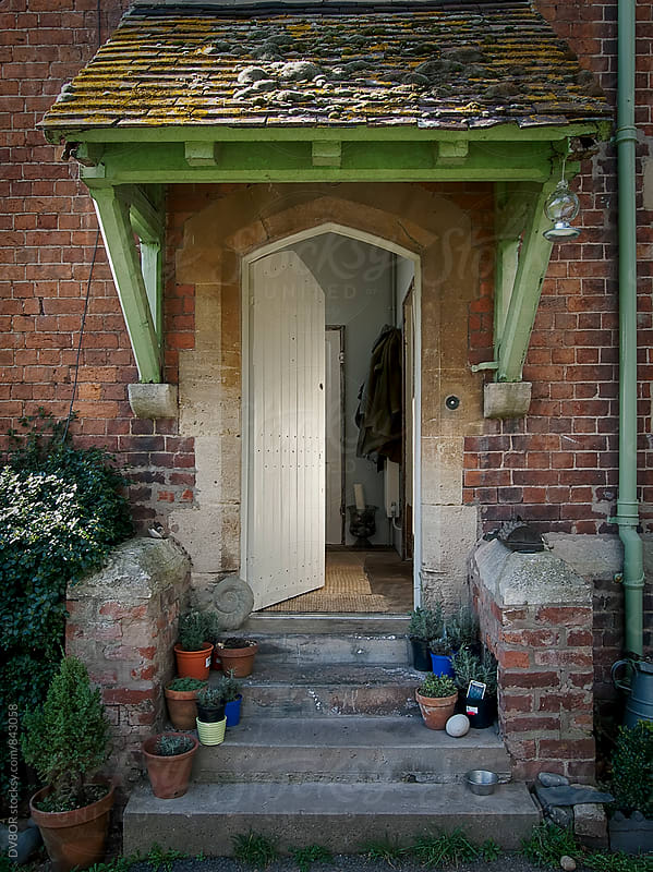Front door for an understated Hipster Red brick English country House by DV8OR for Stocksy United