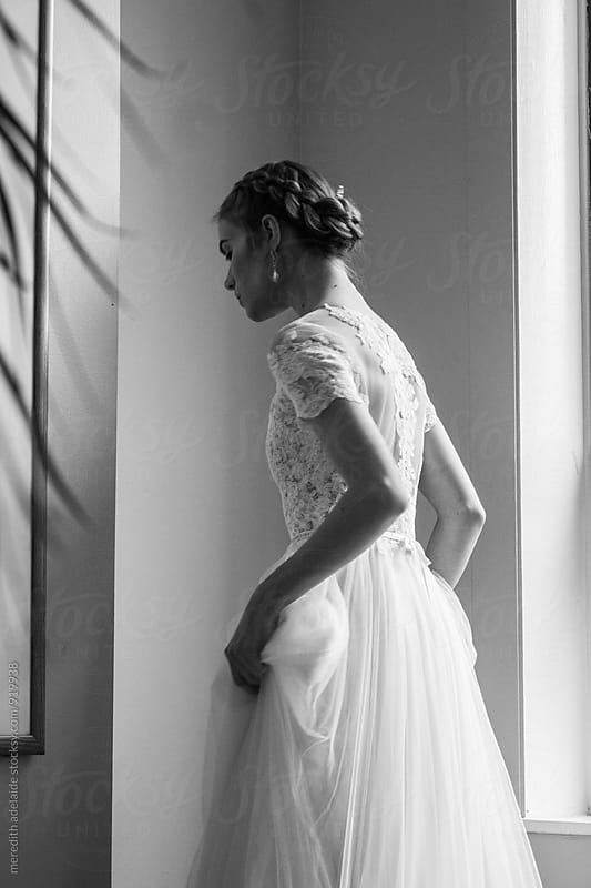 Girl in wedding dress alone by meredith adelaide for Stocksy United