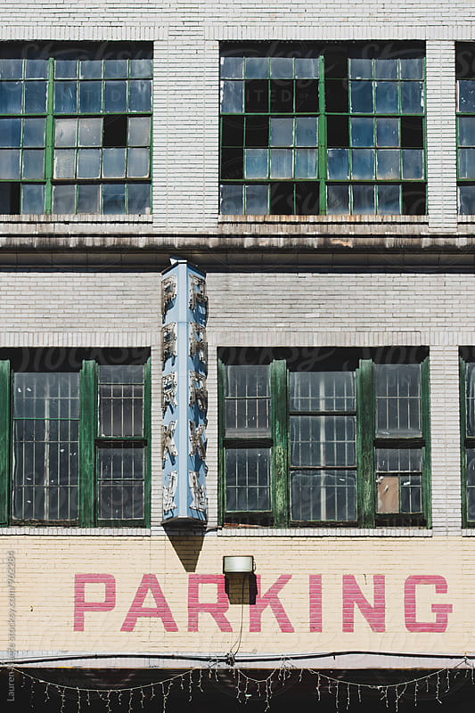 Old parking sign on city building by Lauren Naefe for Stocksy United