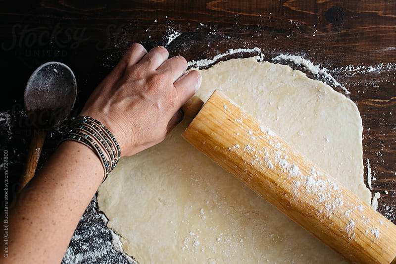 Female's hands rolling  dough by Gabriel (Gabi) Bucataru for Stocksy United
