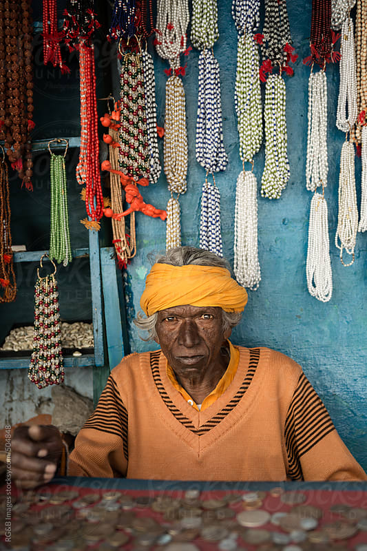 old indian man in his shop  by RG&B Images for Stocksy United