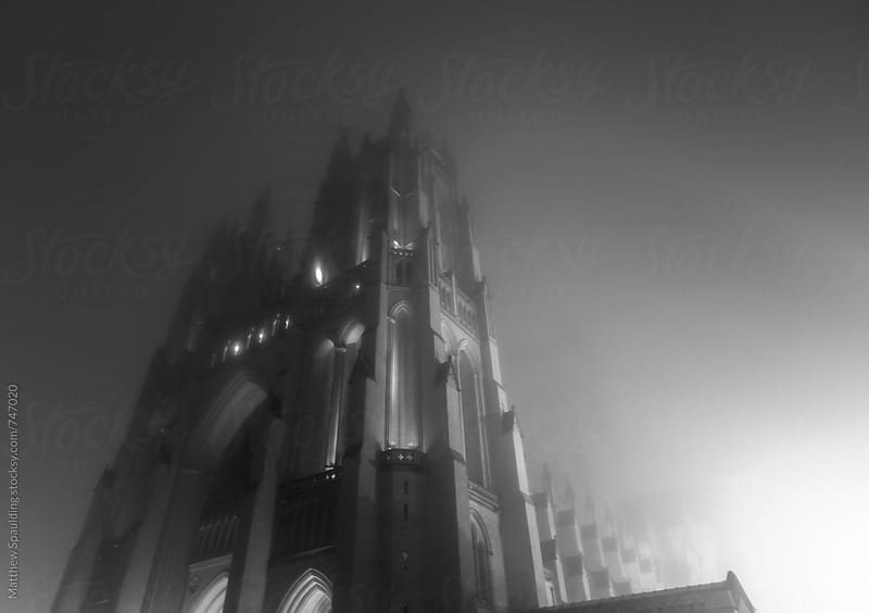 Gothic cathedral in mist on spooky night by Matthew Spaulding for Stocksy United