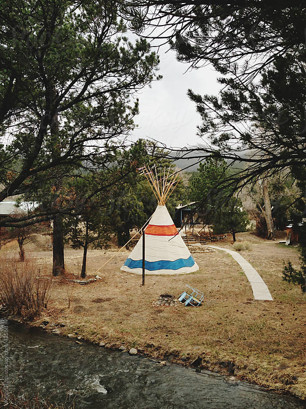 River Teepee Between Trees by Kevin Russ for Stocksy United