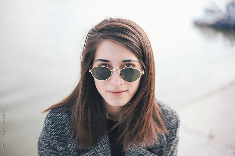 Portrait of a beautiful stylish woman with sunglasses by Marija Mandic for Stocksy United