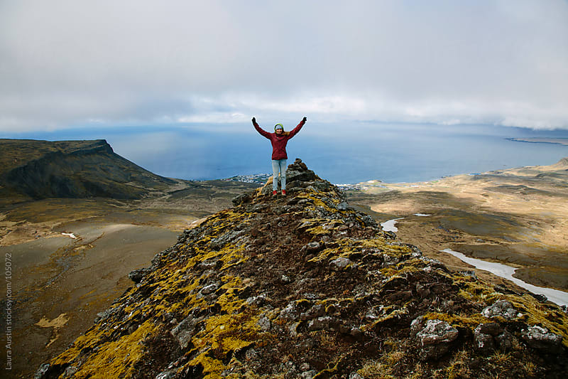 Girl Standing On Top Of A Mountain In Iceland by Laura Austin for Stocksy United