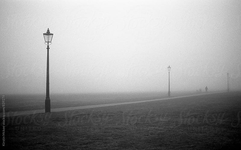Street lights in fog, London by Kirstin Mckee for Stocksy United