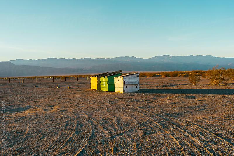 Desert dumpsters by Richard Brown for Stocksy United