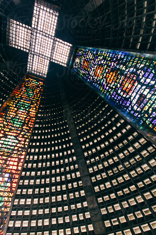Cross and colourful stained glass in Rio de Janeiro cathedral, Brazil travel by Alejandro Moreno de Carlos for Stocksy United