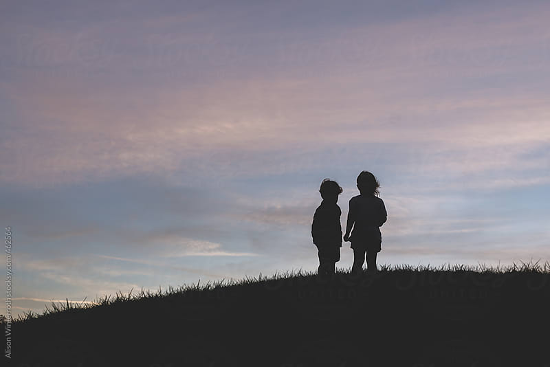 A Girl And  A Boy Look At The Sunset by Alison Winterroth for Stocksy United