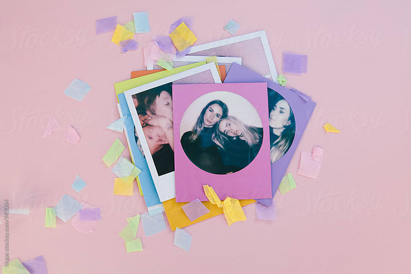 Polaroid print of best friends on a pink background with confetti by kkgas for Stocksy United