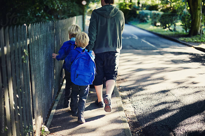 Father and children walking to school by sally anscombe for Stocksy United