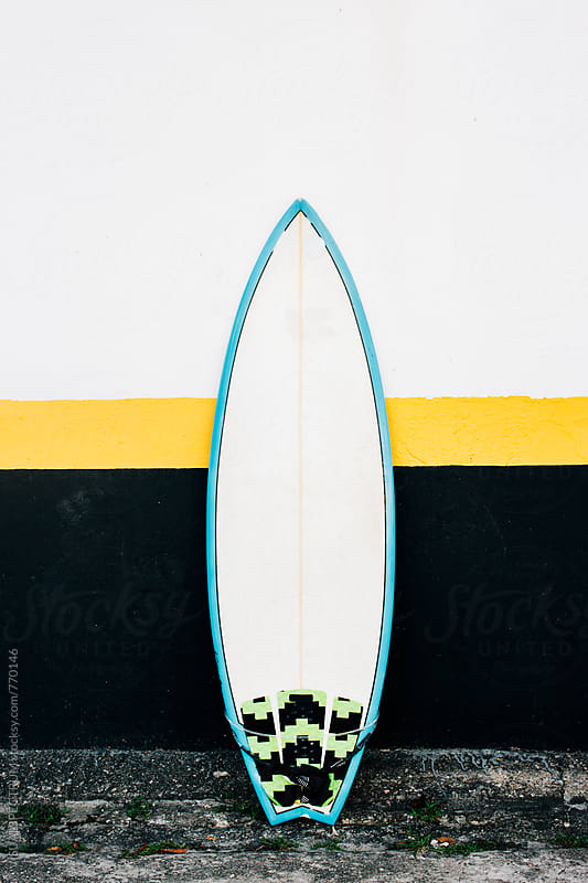 One Surfboard Leaning Against Black Yello White House Facade by VISUALSPECTRUM for Stocksy United