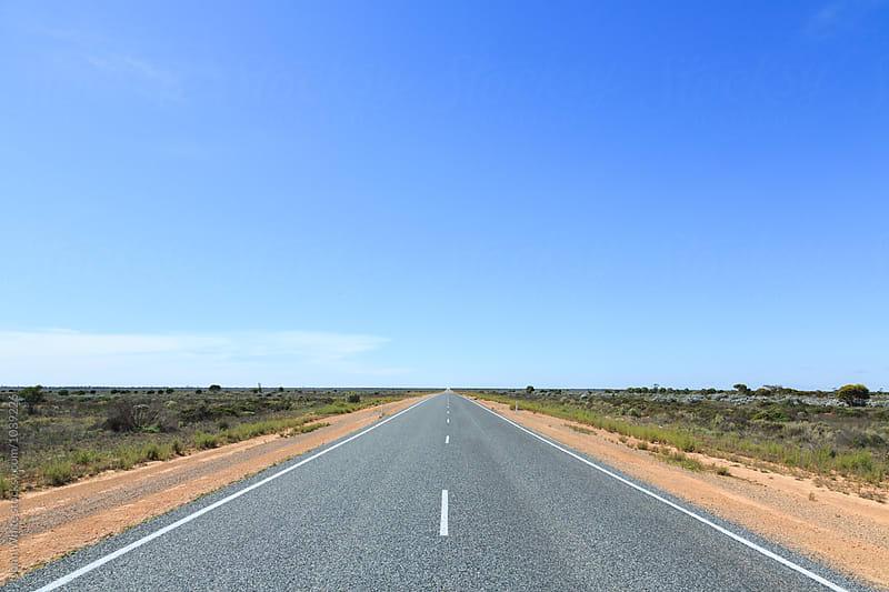 Straight highway across the Nullarbor Plain. Western Australia. by John White for Stocksy United