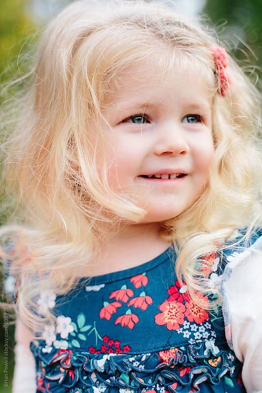 closeup of cute toddler girl by Brian Powell for Stocksy United