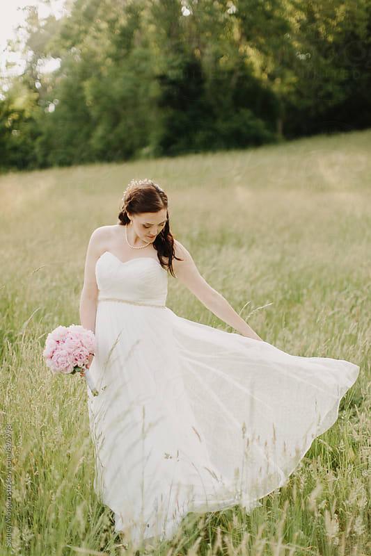Bride in Field by Sidney Morgan for Stocksy United