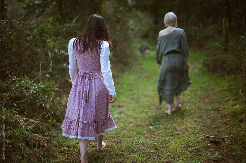 Forest Path Women Walking by Kevin Russ for Stocksy United