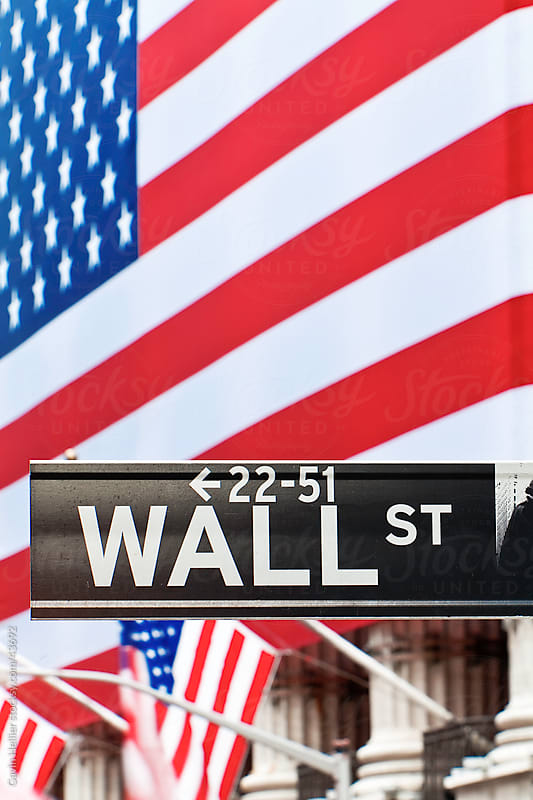 USA, New York City, Manhattan,  Downtown Financial District - Wall Street and the US flag by Gavin Hellier for Stocksy United