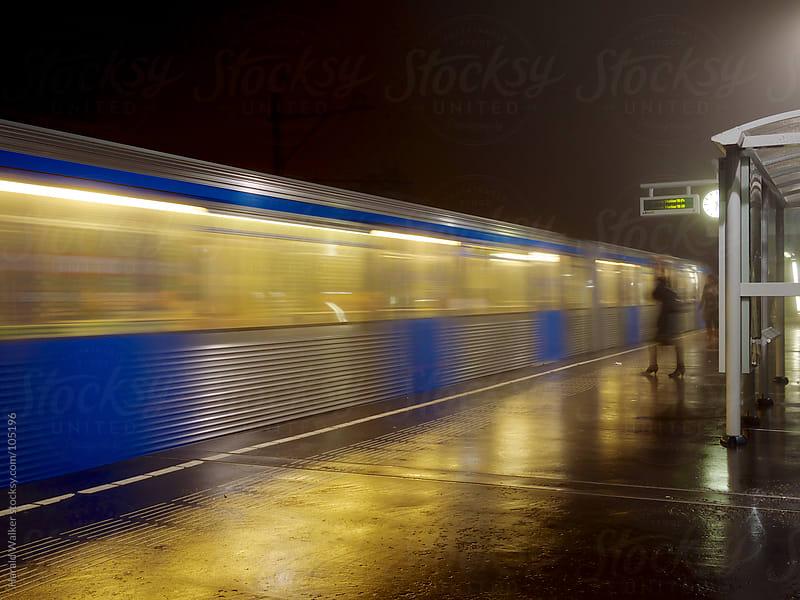 Metro train in foggy night by Harald Walker for Stocksy United